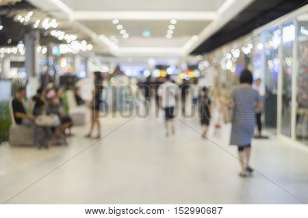 Abstract blurred background of shopping mall.people walking at shopping mall.blurred background.