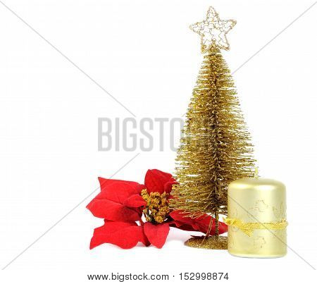 Golden Christmas tree with poinsettia and candle isolated on white