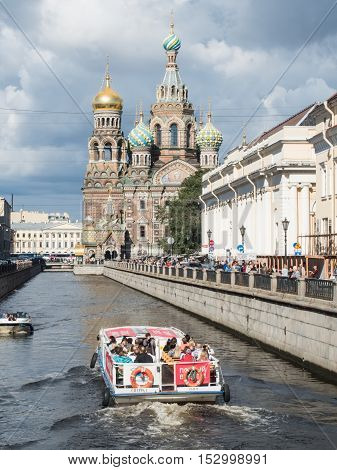 Saint Petersburg Russia September 08 2016: Boat with tourists at the Church of the Savior on bloodin St. Petersburg Russia.