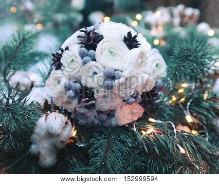 Beautiful Winter Wedding Bouquet Flowers With Decorated Cones On Branch Of Christmas Tree Snow And B