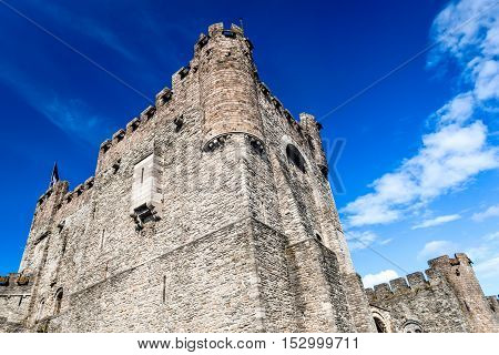 Gent Belgium. Fortified gate of Gravensteen castle in Ghent built in 1180 Middle Ages near river Lieve Flanders landmark.