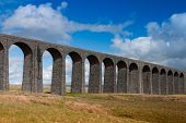Famous Ribblehead Viaduct in the Yorkshire Dales on a sunny day England poster