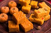 almond, pista, mango and orange flavoured pedha and burfi Indian sweet dish made from milk , dry fruits and fruits, diwali food poster
