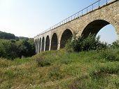 Railway stone bridge viaduct in the Luhansk region of Ukraine. poster