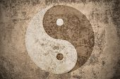 yinyang symbol on a grungy vintage texture with stains, scratches and wrinkles poster