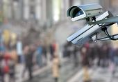 security CCTV camera or surveillance system with traveler on blurry background poster