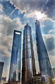 Three Skyscrapers Sun Flare Rainbow Reflections Make Patterns and Designs Liujiashui Financial District Shanghai China. Shanghai Tower Shanghai World Financial Center and Jin Mao Tower poster
