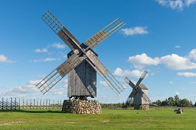 Two traditional wooden windmills in Angla, Island of Saaremaa, Estonia.