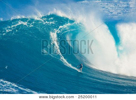 MAUI, HI - MARCH 13: Professional surfer Billy Kemper rides a giant wave at the legendary big wave surf break known as
