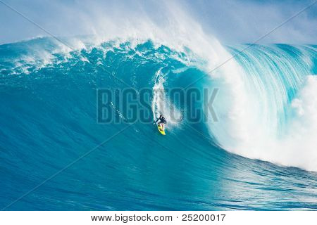 MAUI, HI - MARCH 13: Professional surfer Carlos Burle rides a giant wave at the legendary big wave surf break known as