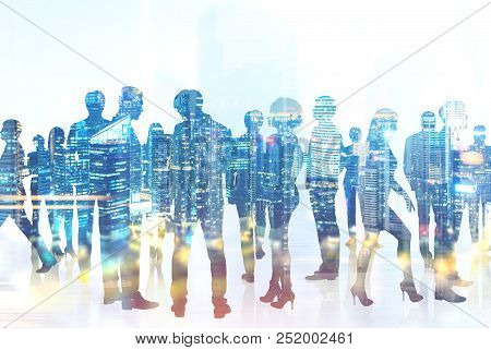 Silhouettes Of Business People Communicating A Against A Night City Background. Concept Of Corporate