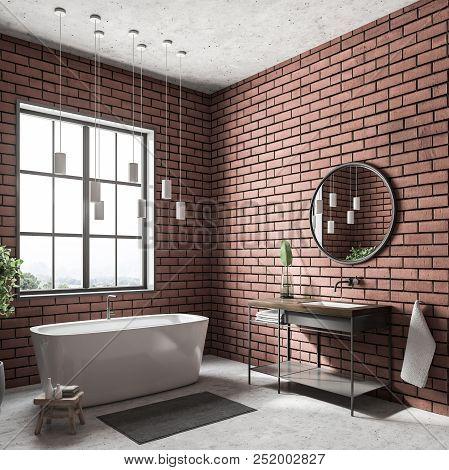 Modern Bathroom Corner With Brick Walls, A White Floor, A Bathtub Standing Under The Window, A Sink