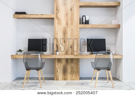White Wall Home Office Or Small Business Owner Work Space In A Neat Room With A Concrete Floor And T