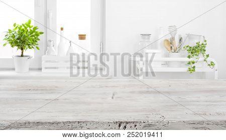 Old Tabletop For Product Display Over Defocused Vintage Kitchen Background