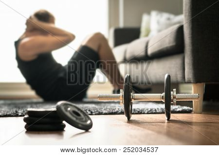 Home Workout. Man Doing Ab Training And Crunches In Living Room Gym. Guy Doing Sit Ups. Warm Up Befo
