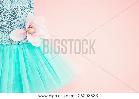 Top View Over The Girl Ballet Tutu Dress Over The Pink Background. Delicate Details Of The Dress For
