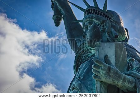 A Side View Of The Statue Of Liberty In New York.