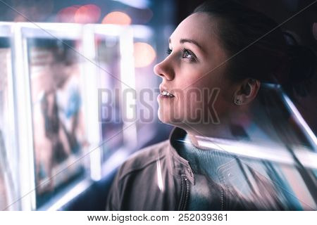 Serious Thoughtful Woman Looking At City Lights At Night In Dark. Dramatic Face With Reflection Of B