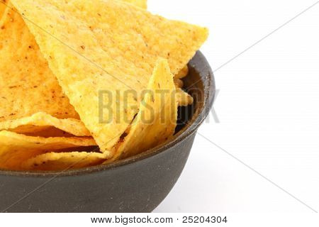 Mexican tortilla chips in brown bowl on white background poster