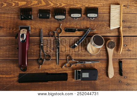 Top View Of Various Professional Barber Tools On Wooden Surface In Hair Salon