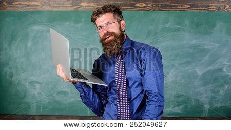 Hipster Teacher Wear Eyeglasses And Necktie Holds Laptop Surfing Internet. Distance Education Concep