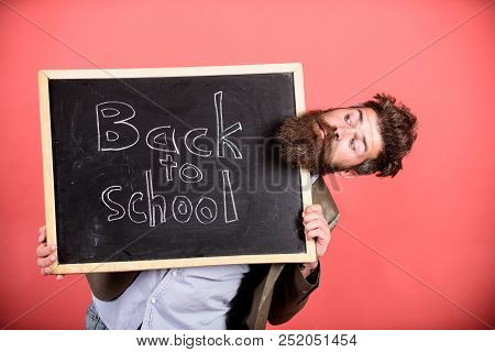 School And Teacher Wait For You. Teacher Or Bearded Educator Stands And Holds Blackboard With Inscri