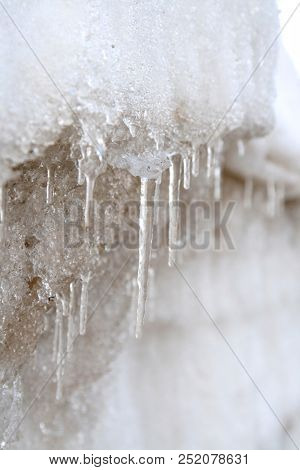 stalactites of ice with water drops
