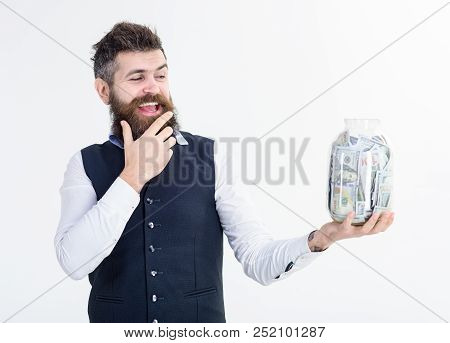 Portrait Of Excited Businessman Holds Jar With Money. Bank Advertising. Saving Money Concept. Bank C