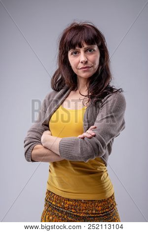 Confident Woman With Folded Arms