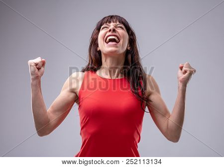 Excited Woman Celebrating With Clenched Fists