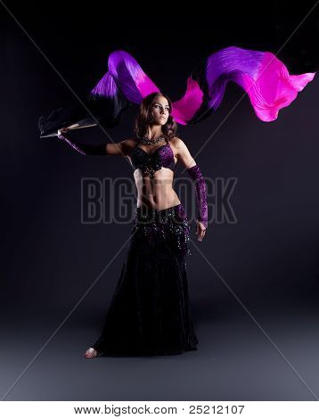 girl in oriental arabic costume dance with fantail