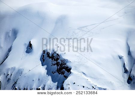 Downhill Skiers Down The Glacier In The Matehorn Area Switzerland.