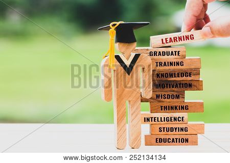 Hand Placing Student Sign Wood With Graduation Cap On Wooden Blocks Tower. Space For Letter E.g Educ