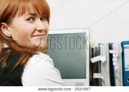 Woman In Office Smiling