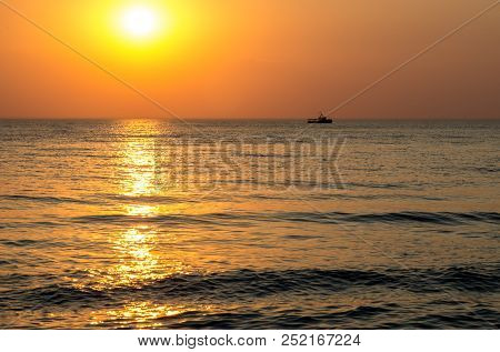 Sunset At Sea. Dawn At Sea. Sunset Over Ship And The Water. The Dawn Of The Sun Above The Water