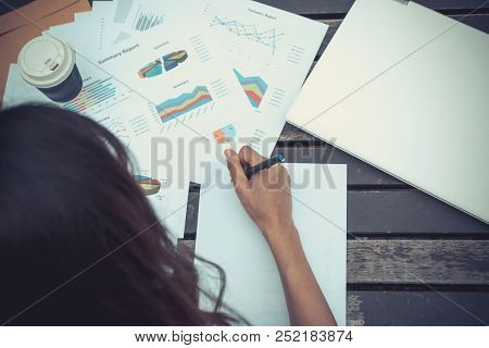 Planning, Strategic Planning Evaluation Of Work Summary Work Plan. Work On A Wooden Desk With Lots O