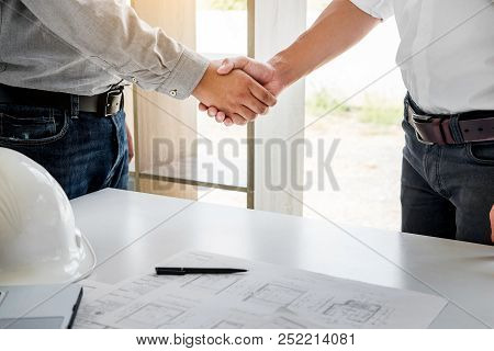 Architecture And Home Renovation Concept - Builder With Blueprint Shaking Partner Hand In Retro Styl