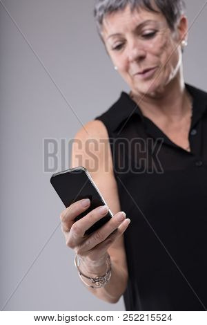 Amused Woman Reading A Text Message