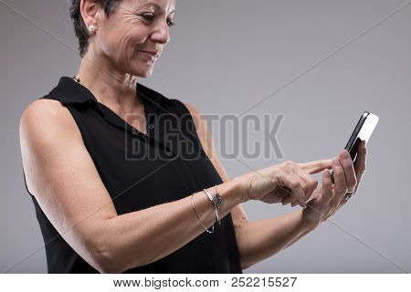 Smiling Woman Typing A Text Message
