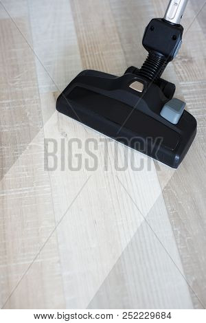 Housework Before And After Concept - Vacuum Cleaner Sweeping Dirty Wooden Floor