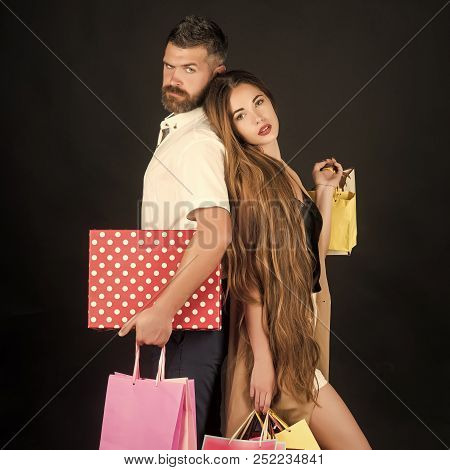 Shopping And Sale. Black Friday, Happy Holiday, Relations. Couple In Love Hold Shopping Bag Near Bla