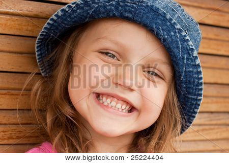 happy kid in jeans hat