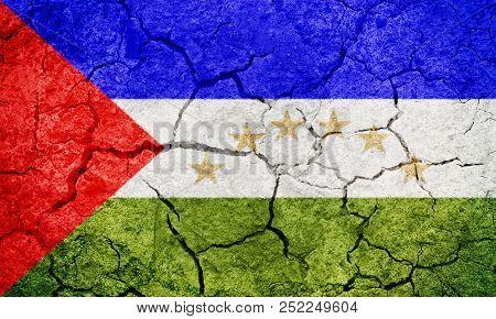 South Caribbean Coast Autonomous Region,  autonomous regions in Nicaragua, flag on dry earth ground texture background poster