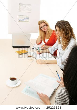 A group of working women issitting on the table - on white background
