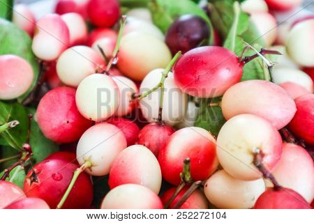 Carunda Or Karonda Fruit And Green Leaves Background