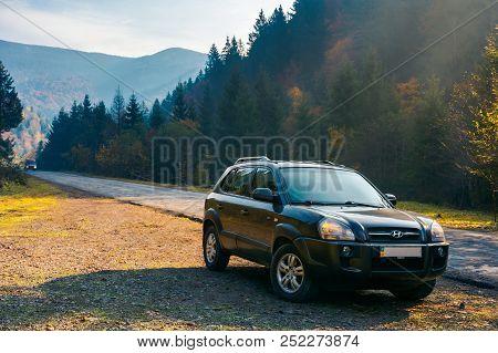 Mizhhirya, Ukraine - Oct 21, 2017:  Hyundai Tucso 2010 Suv On The Road Side In Forested Mountain. Lo