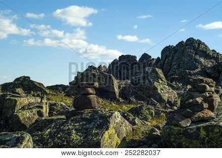 Stone Pyramid - A Road Sign For The Designation Of A Trail In The Fog - In A Beautiful Mountainous W