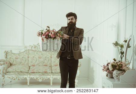 Design Concept. Hipster Hold Flower Arrangement In Basket, Design. Eco Design In Home Interior. Flor