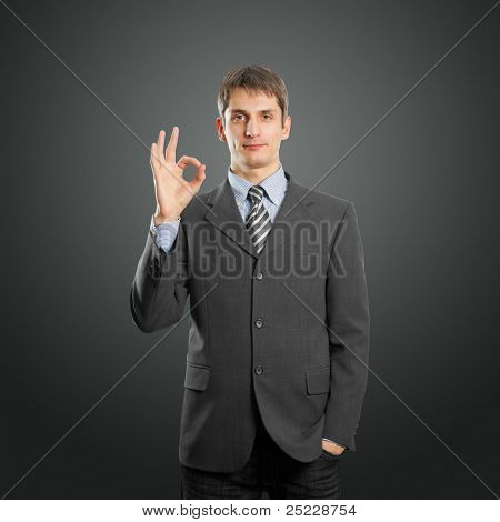 happy businessman shows OK against different backgrounds