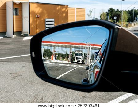 Rear View Mirror Reflection Truck Filling Gas